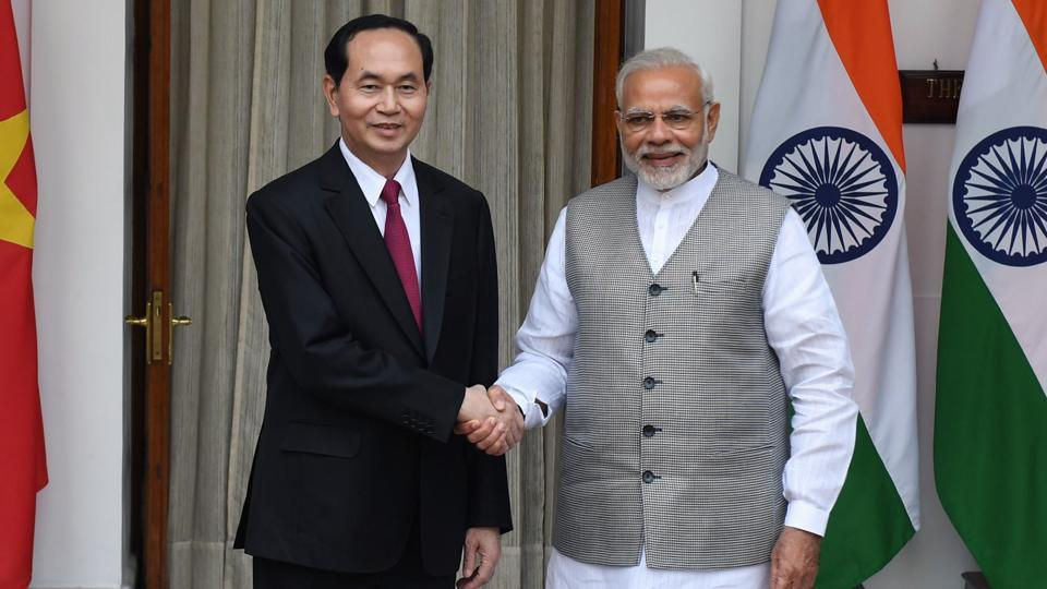 Prime Minister Narendra Modi shakes hands with Vietnam's President Tran Dai Quang prior to a meeting and agreement signing in New Delhi on March 3.