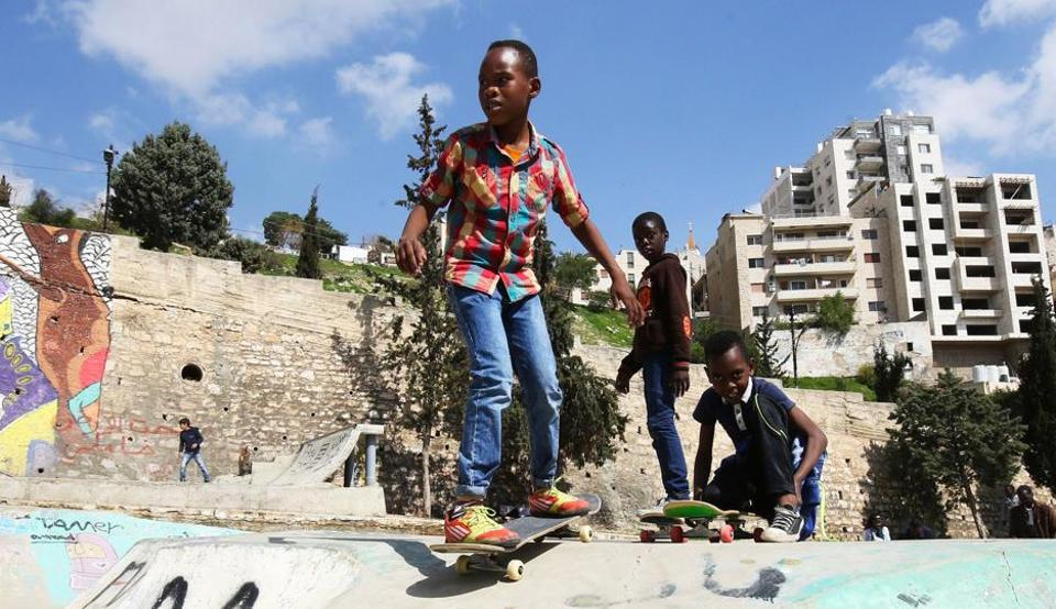 Refugee children skate at the 7 Hills Skate Park in Amman.
