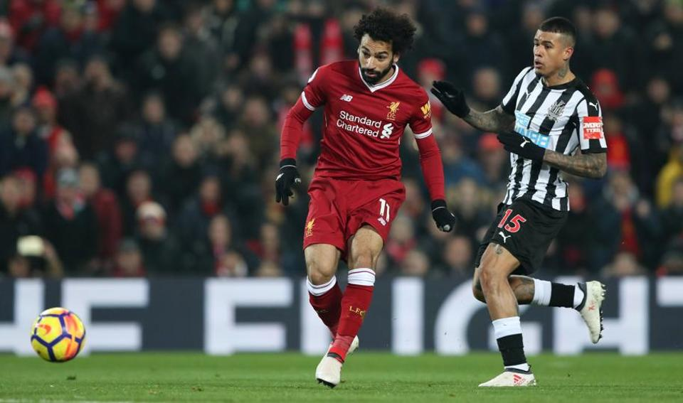 Liverpool's Mohamed Salah scores their first goal against Newcastle United in the Premier League on Sunday.