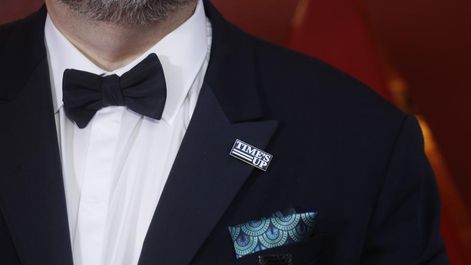 "Best Director Nominee Guillermo del Toro wears a Times Up pin during the Oscar arrivals in California. There was no #MeToo or Time's Up dress code on the Oscar red carpet. But the topic was a major talking point of the evening — and host Jimmy Kimmel got right to it in his opening monologue. ""Here's how clueless Hollywood is about women,"" Kimmel said. ""We made a movie called       'What Women Want' and it starred Mel Gibson."" (Carlo Allegri / REUTERS)"