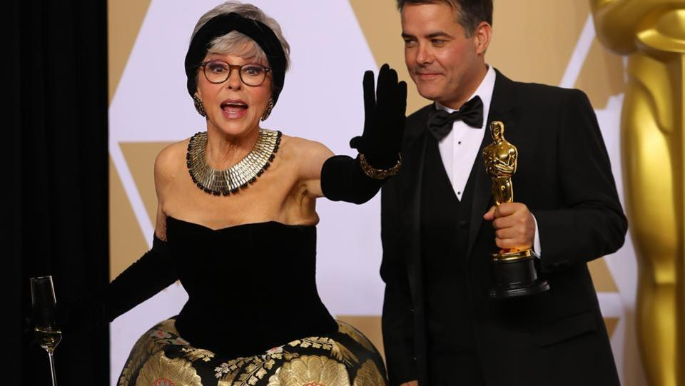 Rita Moreno poses with director Sebastian Lelio from Chile after he won the Oscar for Best Foreign Language Film for