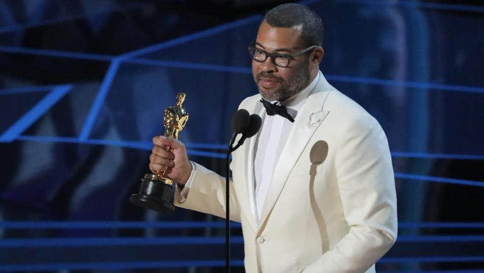 "Jordan Peele won for his script to his horror sensation ""Get Out,"" becoming the first African-American to win for best original screenplay. Peele, said he stopped writing it ""20 times,"" dubious that it would ever get made. (Lucas Jackson / REUTERS)"