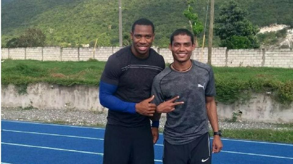 Nisar Ahmed (right) with Jamaican Olympic medallist Yohan Blake at Usain Bolt's coach's training centre.