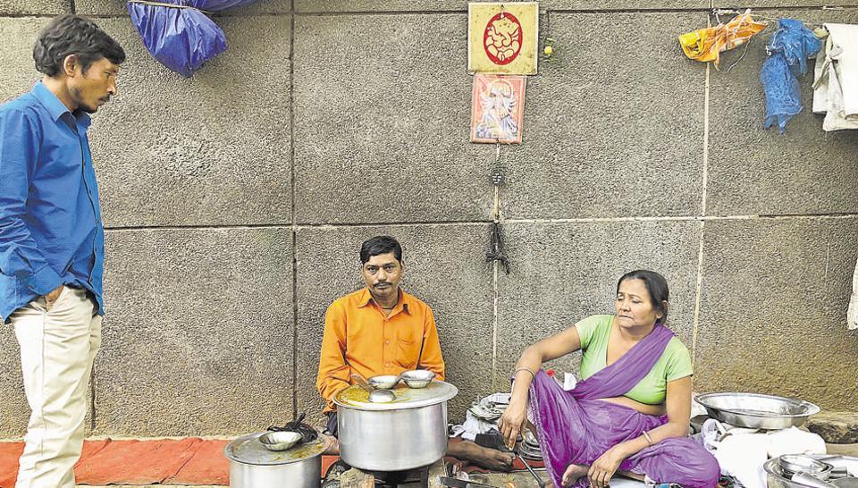 Beena Devi and Madan Lal  at their roadside eatery in Sadar Bazaar.