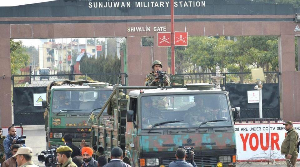 Security forces' personnel stand guard at Sunjuwan Military Station in Jammu during a militant attack.