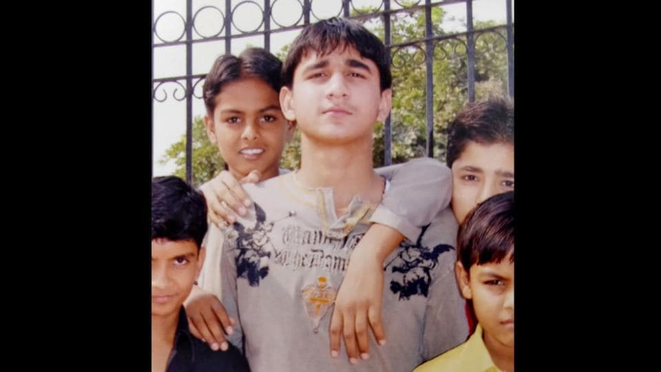 Abhishek Tyagi (C), Akash Yadav's victim and classmate. As Azad Singh returned from consulting an astrologer specializing in stolen objects regarding his gun, he received a call from his sons' school informing him that Akash had shot his classmate after classes had ended. Two bullets hit Abhishek in the forehead and two in the chest. By the time his parents reached the hospital, Abhishek had died. (HT Photo)