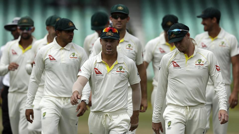 Australia's David Warner, center, leaves the field with teammates at the end of the fifth and final day of the first Test against South Africa at Kingsmead Stadium in Durban.