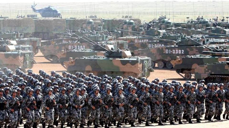 Soldiers of China's People's Liberation Army take part in a military parade.