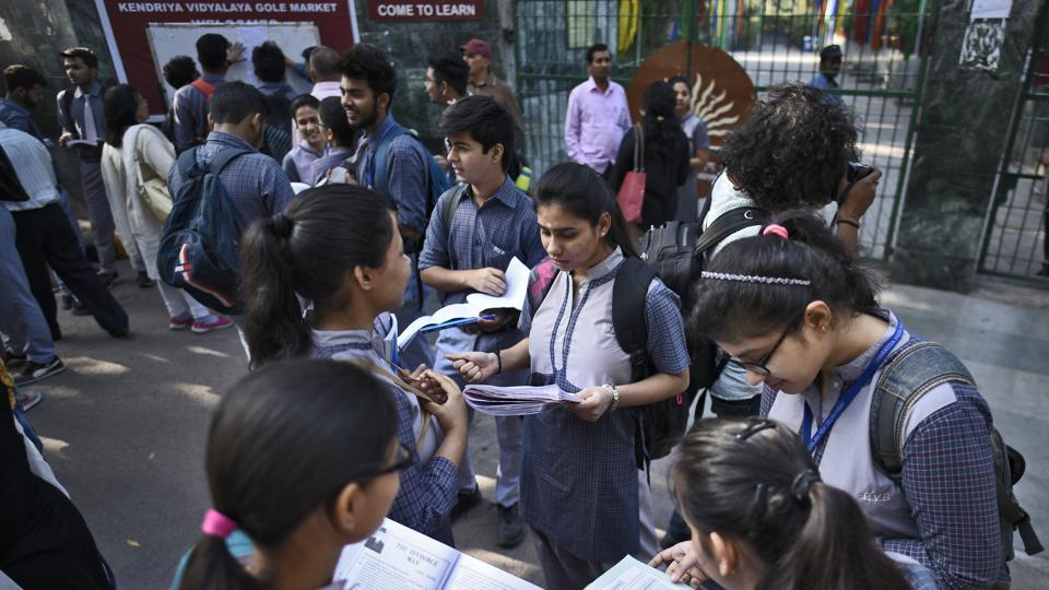 Students doing their last minute revision, outside their examination centre at a school in Gole Market, New Delhi on Monday. CBSE board exams began today.