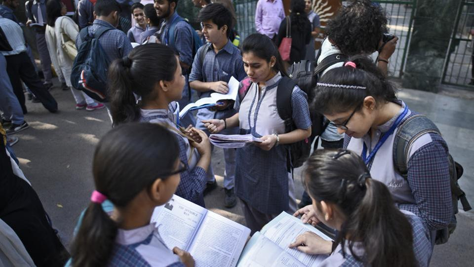 Students of Class X and XII are seen caught up in last minute revisions, outside an examination centre, at Kendra Vidyalaya Gole Market in New Delhi. For the Class 12 exam, 11,86,306 candidates had registered and exams began today at 4,138 centres in India and 71 centres abroad. (Burhaan Kinu / HT Photo)