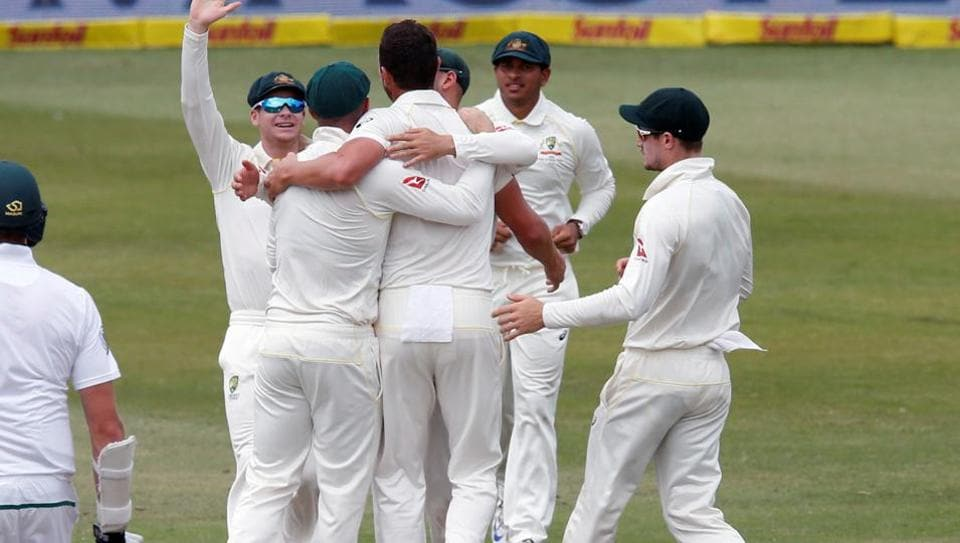 Australia celebrate beating South Africa in the first Test match at Kingsmead in Durban on Monday.