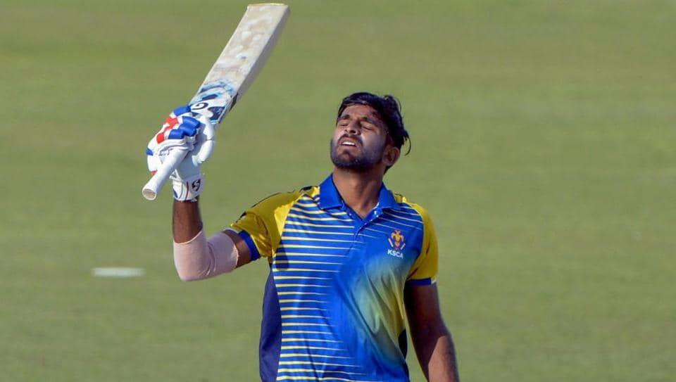 Ravikumar Samarth of Karnataka raises his bat after his century against India B in the Deodhar Trophy match at Dharamshala, Himachal Pradesh on Monday.
