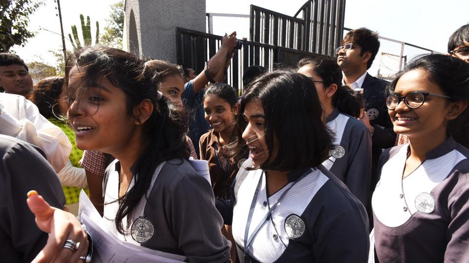 Students coming out after appearing in the first paper of the class 12th Examinations of CBSE at an examination centre in Noida on Monday.