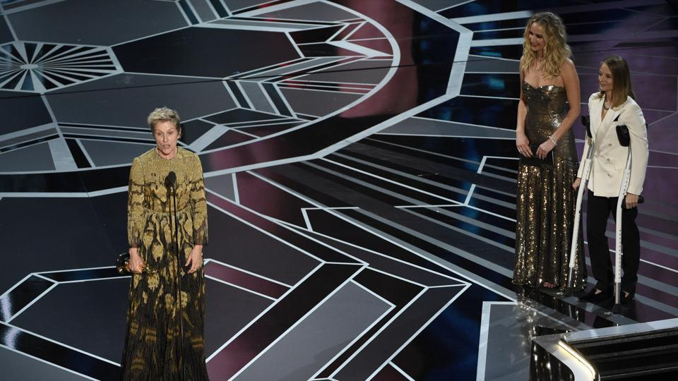 Frances McDormand accepts the award for best performance by an actress in a leading role for 'Three Billboards Outside Ebbing, Missouri' as Jennifer Lawrence and Jodie Foster look on from right at the Oscars. The 90th Academy Awards kicked off at the Dolby Theatre in Hollywood on Monday. Guillermo del Toro's romance fantasy The Shape of Water led nominations with 13 nods, followed by eight nominations for Christopher Nolan's epic World War II film, Dunkirk. (Chris Pizzello/Invision/AP)