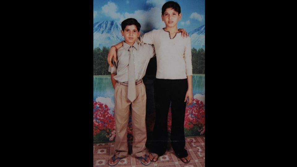 "Akaksh (R) in a 2007 photo with his brother Sumit. The feud between Abhishek and Akash was over a girl Sumit maintains. With few having heard of school shootings in India, conversation soon revolved around the effects of ""new, property-driven wealth"" and ""modernity"" on the minds of these children. On December 11, 2007 the court sent Akash to Faridabad's juvenile observation home for three years. (HT Photo)"