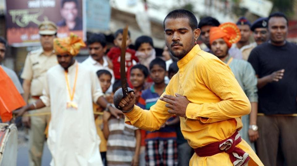 A man performing during the Shiv Jayanthi celebrations at Nana peth on Sunday. (rahul raut/ht photo)