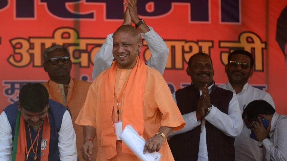 Chief minister of Uttar Pradesh, Yogi Adityanath looks on towards a crowd during a public meeting for BJP's candidate Kaushlendra Singh Patel for the bypoll to Phulpur (Allahabad) Lok Sabha seat in Allahabad on March 4.