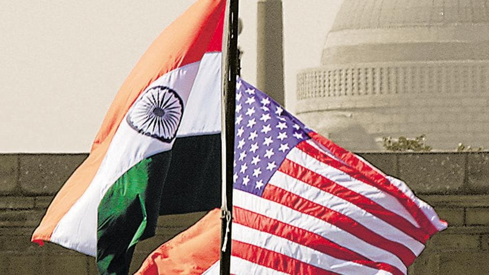 Indian and US national flags flutter in front of the Rashtrapati Bhawan in New Delhi.