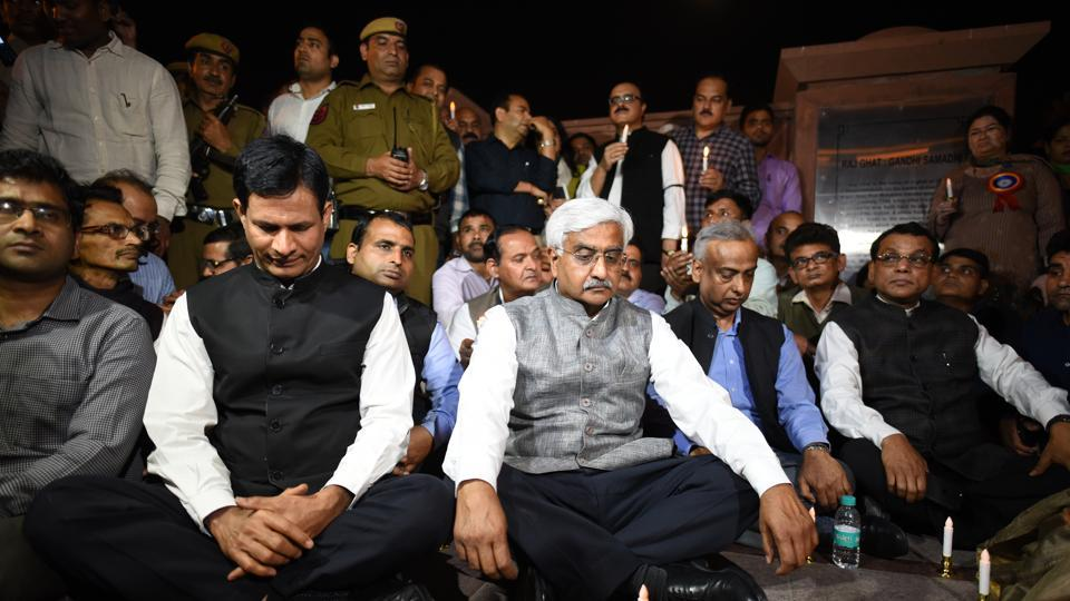 Chief secretary Anshu Prakash (seated right in the front row) along with other officers and employees of Delhi government during the March for Dignity protest, Rajghat, New Delhi, February 28