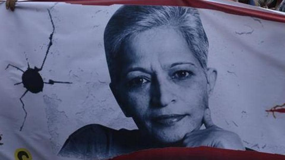 A banner with journalist Gauri Lankesh's photo during a protest march in New Delhi last year.