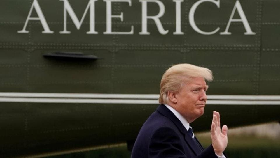 President Donald Trump walks on the South Lawn after returning to the White House, February 1.  Revoking the work permits is expected to regulate high-skilled immigration as Trump pushes his 'America First' agenda.