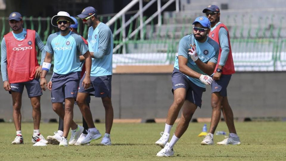 India's captain Rohit Sharma (2R) participates in a fielding practice session ahead of the tri-nation Twenty20 cricket series in Colombo, Sri Lanka on Monday, March 5, 2018. The Twenty20 tri-series that features Bangladesh, India and Sri Lanka begins on March 6.
