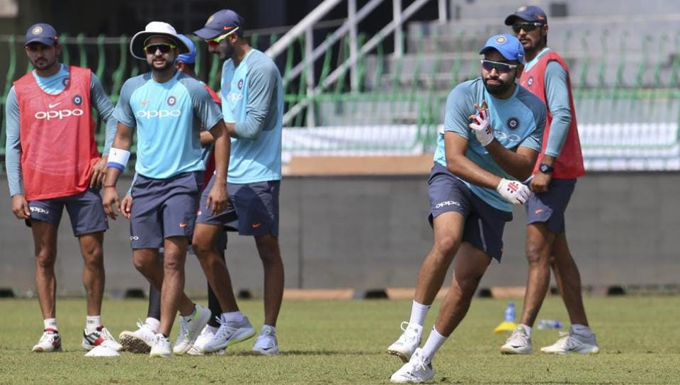 India captain Rohit Sharma, right, participates in a fielding practice session ahead of the tri-nation T20 cricket series in Colombo. (AP)