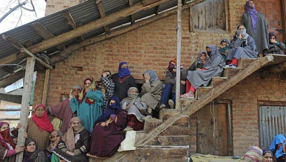 Relatives and neighbours watch the funeral procession of Suhail Ahmad Wagay who was killed on Sunday night.