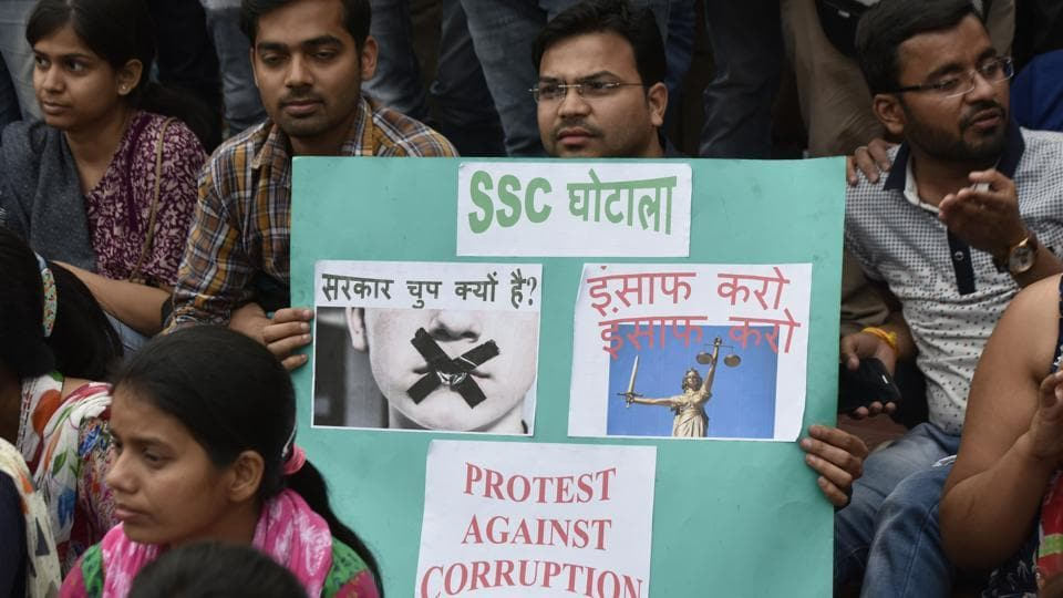 Staff Selection Commission candidates sit on a dharna in front of the office in protest against the examination paper leak in New Delhi on March 4.