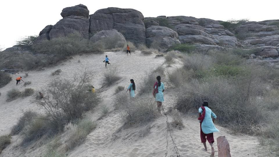 Popularly known as 'Ret ka Tila' (sand dune), girls from the Veerni Institute run up the mound in the evening after classes to play. Veerni, a residential institute in the desert of Rajasthan, is giving child brides and other girls a chance to finish school, graduate, pick and pursue a career. (Anushree Fadnavis / HTPhoto)