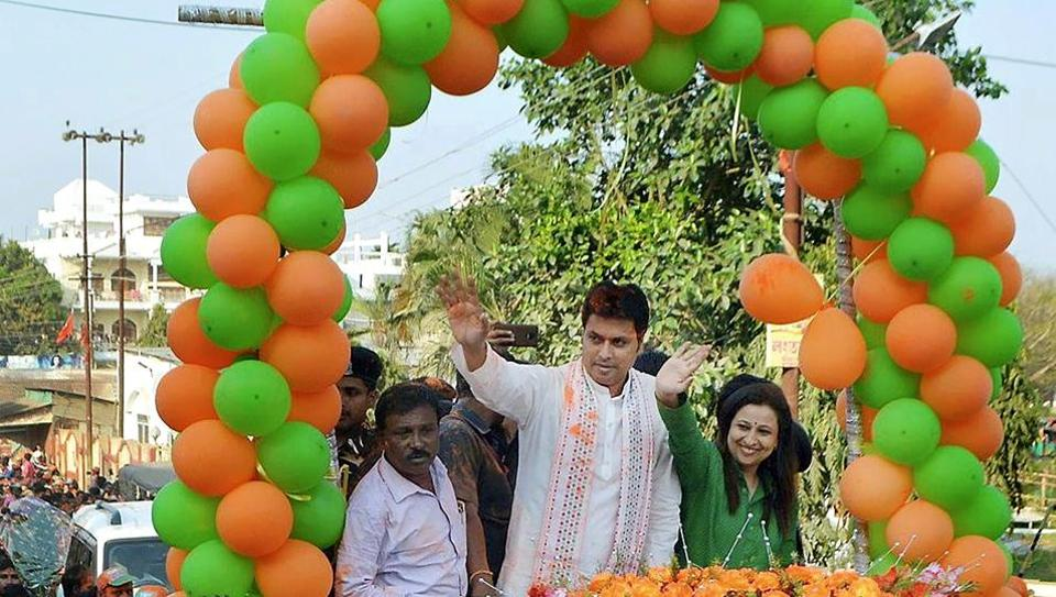 BJP Tripura state president Biplab Deb with party supporters celebrate party's victory in the state assembly election during 'Vijoy' rally, in Agartala on March 4.