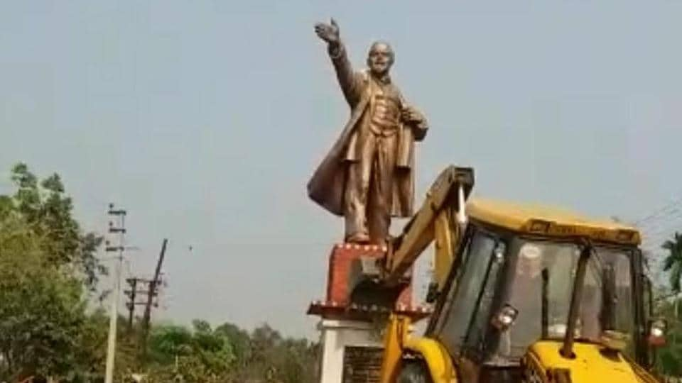 Statue of Lenin being demolished at Belonia town in South Tripura on Monday with the help of a bulldozer.