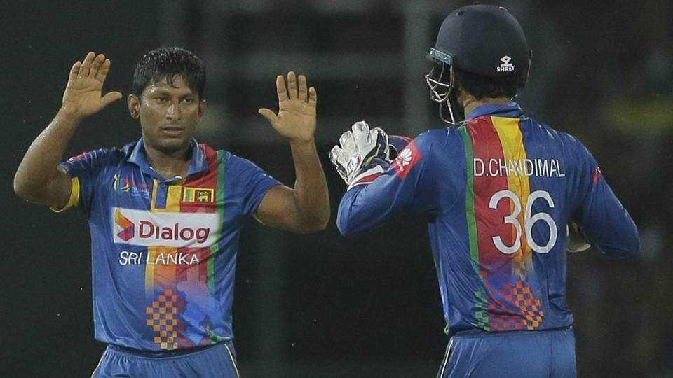 Sri Lanka's Jeevan Mendis, left, celebrates after taking the wicket of India's Manish Pandey. (AP)