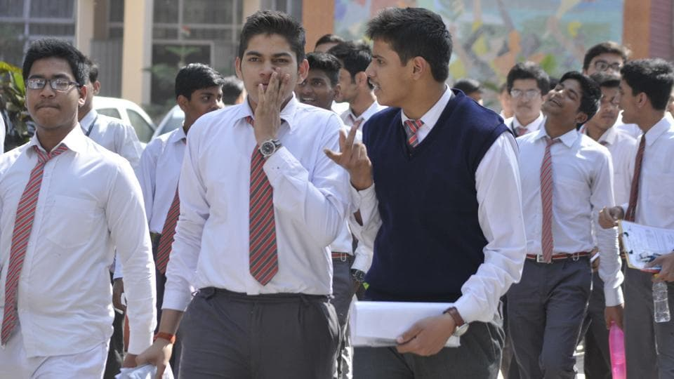 Students of CBSE board Class 10 coming out from the examination centre after appearing in Hindi paper at Central Academy in Lucknow, UP on Tuesday.
