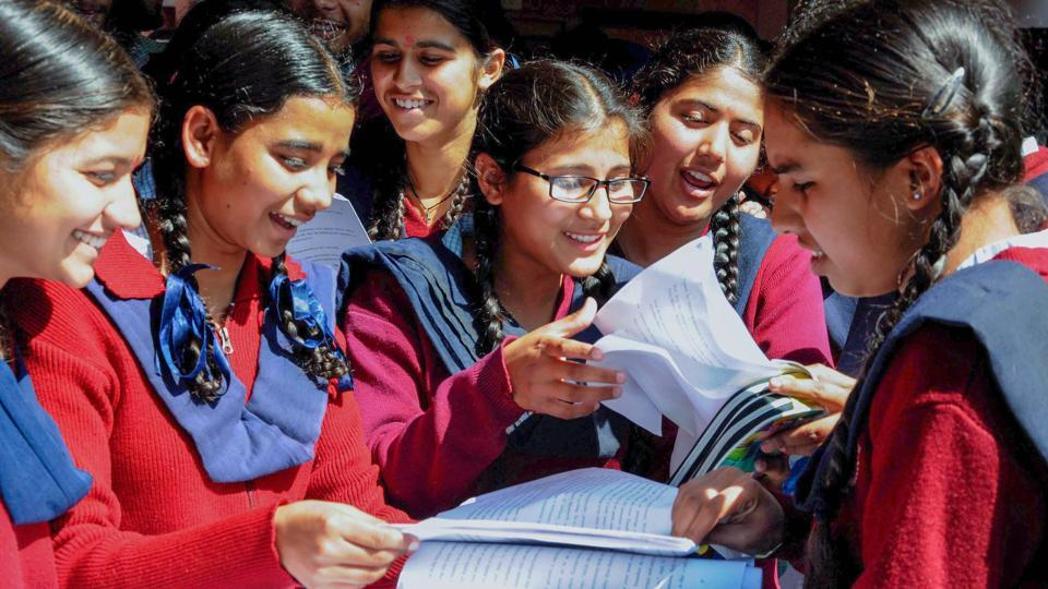 Students discuss after appearing for the CBSE Class 12 exam in Amritsar on Monday.