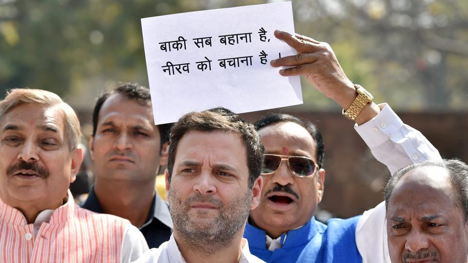 Congress president Rahul Gandhi and Party leaders protest outside Parliament during second phase of Budget Session in New Delhi on Tuesday.