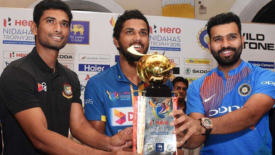 Captains Dinesh Chandimal (C) of Sri Lanka, Rohit Sharma (R) of India and Mahmudullah Riyad (L) of Bangladesh pose behind the Nidahas tri-nation Twenty20 tournament series trophy in Colombo on Sunday.