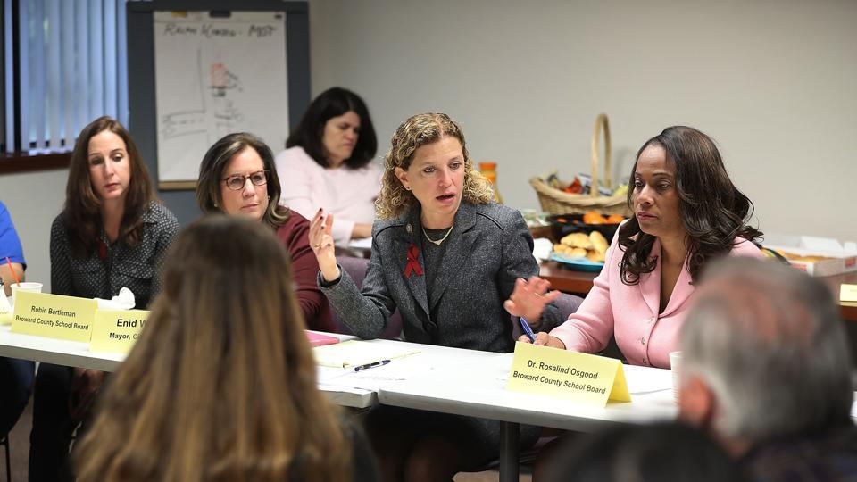 Rep. Debbie Wasserman Schultz (C) (D-FL) hosts a gun safety roundtable discussion that brought together community leaders, school board members, police officers, clergy and students calling for more gun control on March 5, 2018 in Sunrise, Florida.