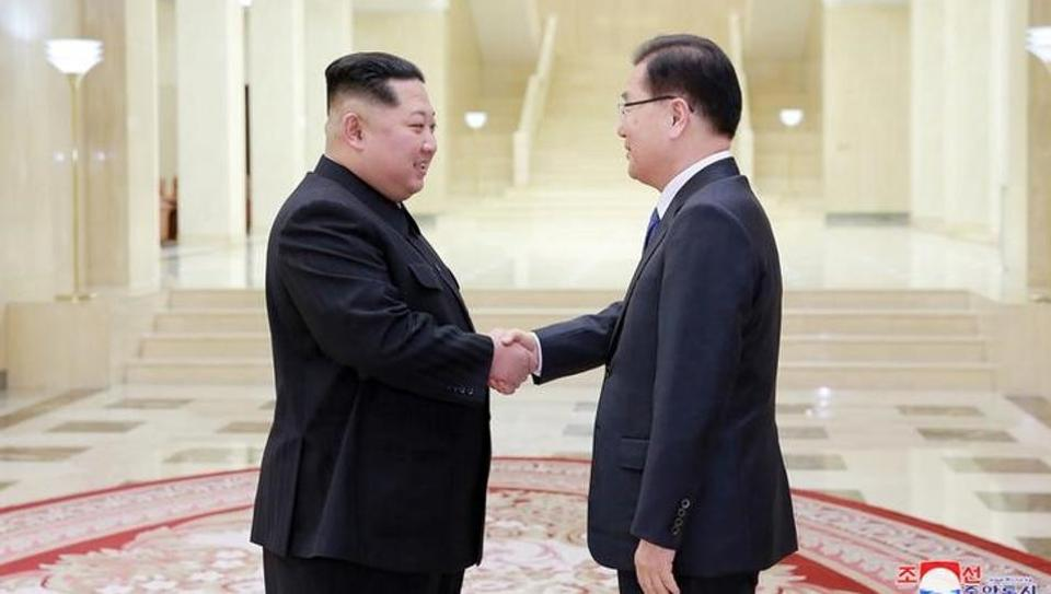 North Korean leader Kim Jong Un shakes hands with a member of the special delegation of South Korea's President in this photo released by North Korea's Korean Central News Agency (KCNA) on March 6, 2018.