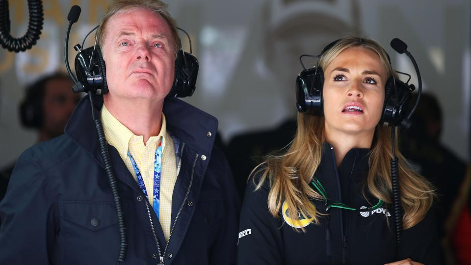 File -- Former F1 driver Jonathan Palmer and Carmen Jorda of Spain watch during the Formula One Grand Prix of China at Shanghai International Circuit on April 10, 2015.