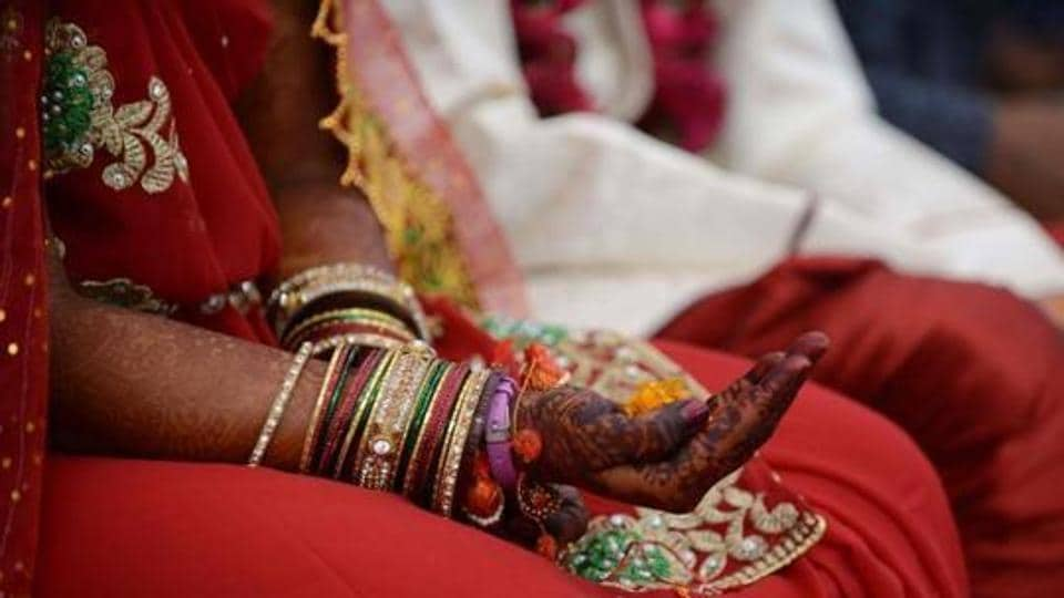 The woman, in her bridal attire, lodged an FIR against the bridegroom who allegedly misbehaved with her parents after getting drunk.