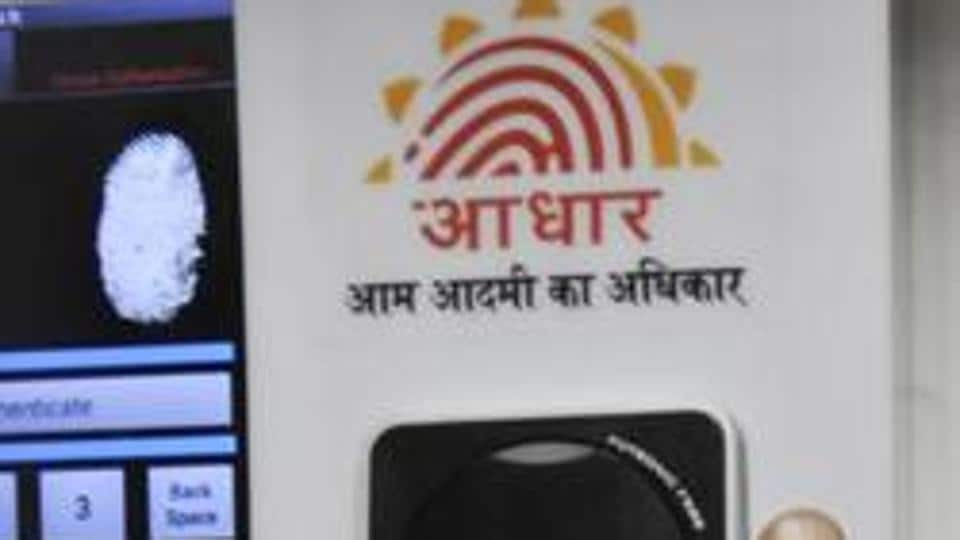 File photo of employees marking their attendance through the Aadhaar-based system in the Planning Commission in New Delhi.