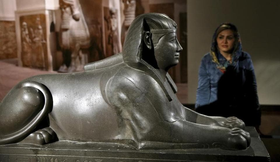 An Iranian woman looks at Royal Sphinx sculpture during the inauguration of an exhibition called The Louvre in Tehran.