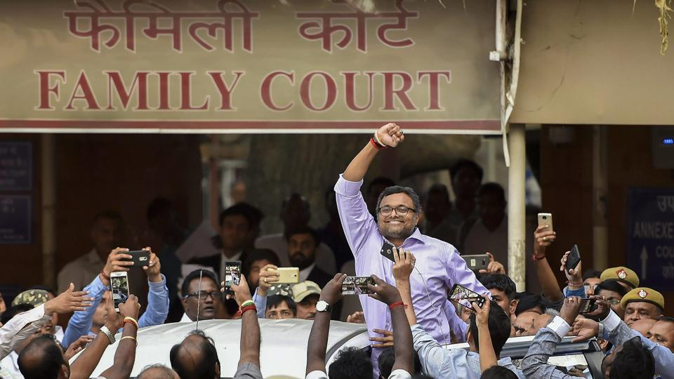 Karti Chidambaram reacts before his supporters as he leaves Patiala House Courts after appearing in INX case in New Delhi on Tuesday.