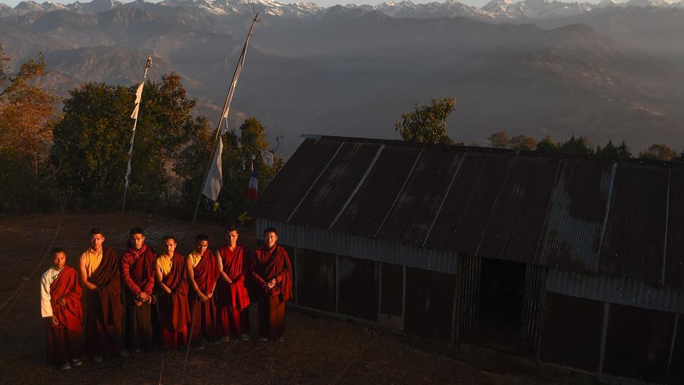 Swapping maroon robes for running gear, seven Buddhist monks in the foothills of Nepal's Himalayas are training to become ultra-marathon runners, hoping the sport will put their remote village on the map and provide funds needed to rebuild homes destroyed by a massive earthquake nearly three years ago. (Paavan Mathema / AFP)