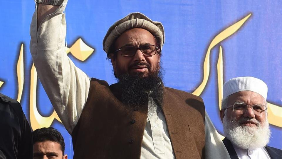 Pakistani head of the Jamaat-ud-Dawa (JuD) terror group Hafiz Saeed waves during a rally in Lahore.