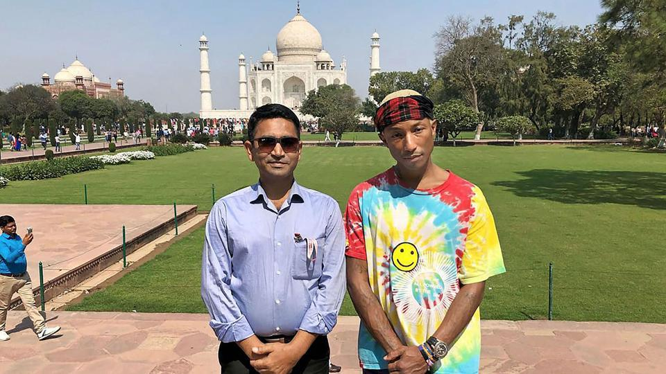 American musician Pharrell Williams poses in front of Taj Mahal in Agra on Tuesday.