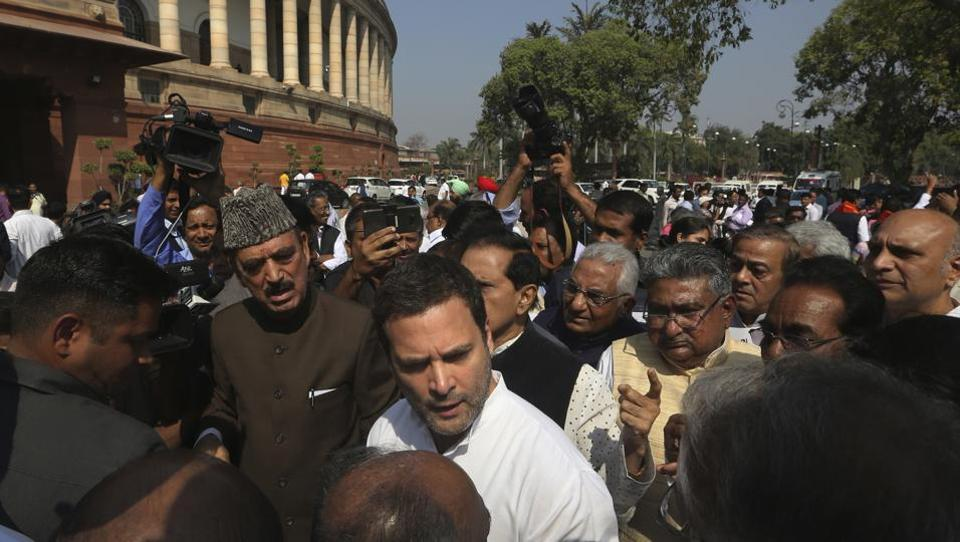 Congress president Rahul Gandhi, centre, talks to party leaders during a protest outside Parliament, in New Delhi on Tuesday.