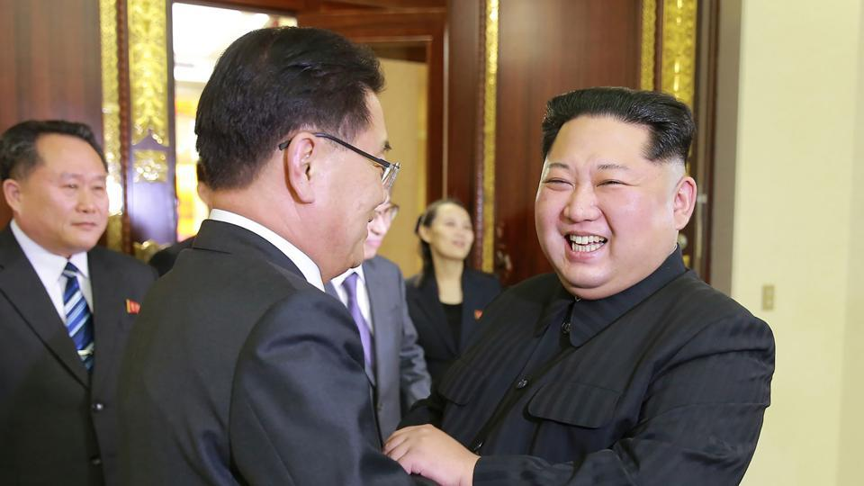 North Korean leader Kim Jong-Un (R) greets South Korean chief delegator Chung Eui-yong, who travelled as envoys of the South's President Moon Jae-in, during their meeting in Pyongyang.