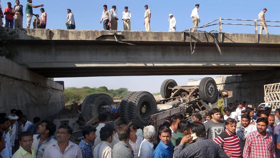 As many as 28 people died and 35 others were injured when a truck carrying wedding guests and family fell off a bridge in Gujarat's Ranghona village in Bhavnagar district early on Tuesday. The vehicle going from Palitana to Botad fell off the bridge into the dry river bed of Ranghona river. (PTI)
